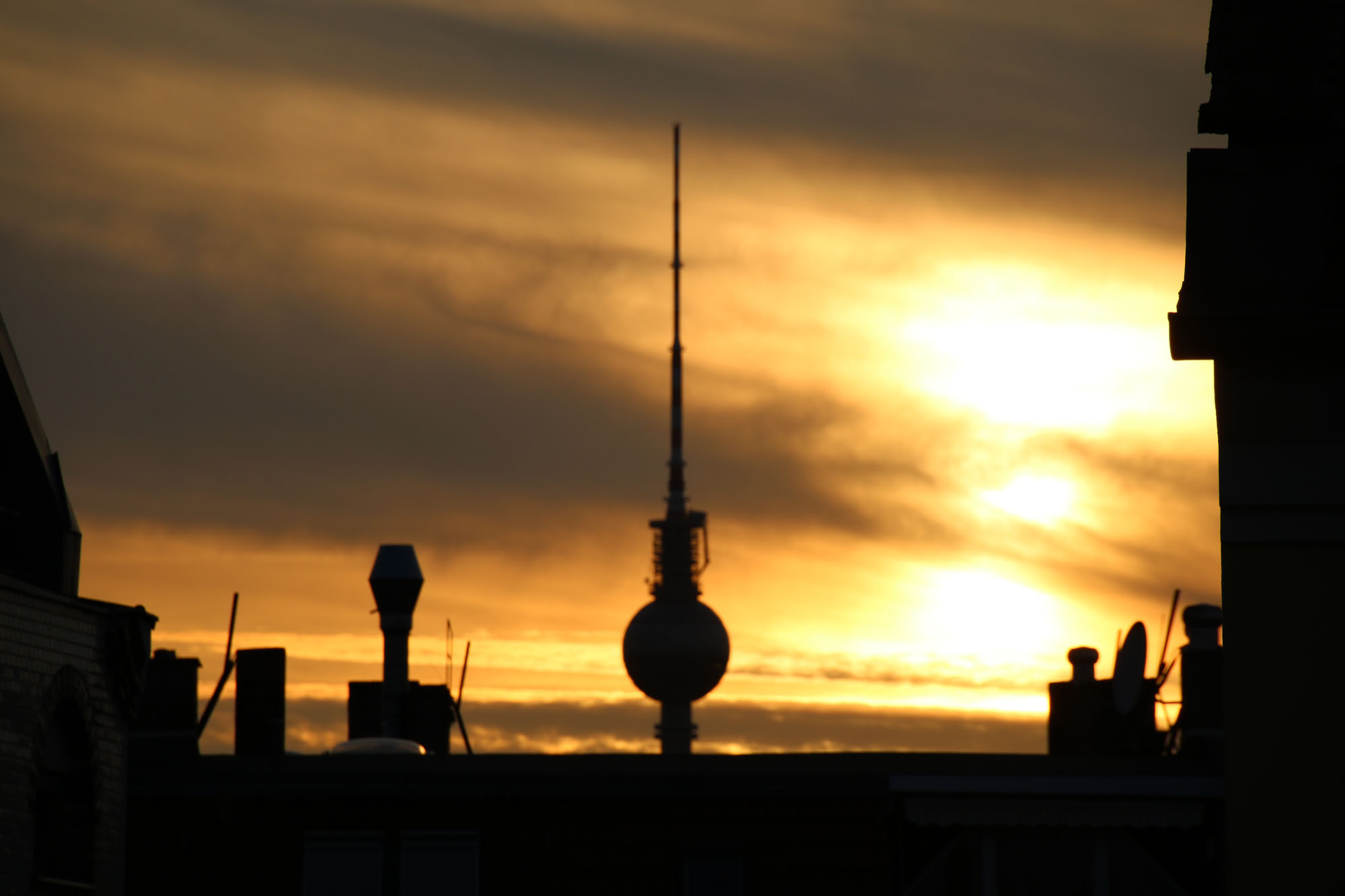 sunset behind tv tower